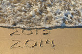 New year 2014 on the beach — Stock Photo
