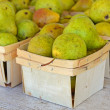 Ripe pears in produce boxes — Stock Photo