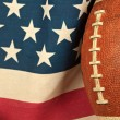 Football on an American flag — Stock Photo