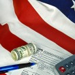 Income tax form on flag — Stock Photo #34092971