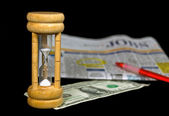 Sand timer with dollar bill — Stock Photo