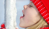 Girl licking snow — Stock Photo