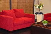 Red couch in living room — Stock Photo