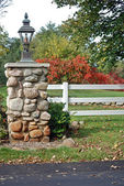 Stone pillar with fence — Stock Photo