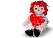 Old rag doll with red heart — Stock Photo