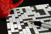 Crossword puzzle with red mug — Stock Photo
