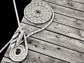 Nautical rope on dock cleat — ストック写真