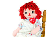 Old rag doll with lollipop — Stock Photo