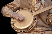 Bronze banjo player — Stock Photo