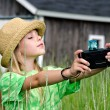 Girl with old-fashioned camera — Stock Photo