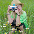 Girl with old camera — Stock Photo #48811795