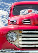 Classic red truck with fuzzy dice — Stock Photo