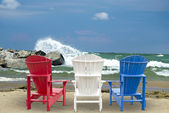 Adirondack chairs on beach — Foto Stock
