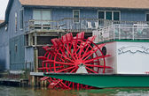 Red paddle wheel boat — Stock Photo