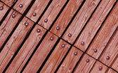 Wood with rivets — Stock Photo