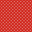 Seamless polka dot red pattern with hearts. — Stock Vector