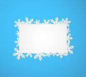 Blue Christmas background with paper snowflakes. — Stock Vector