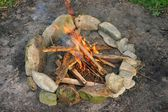 Circle Fireplace with Burning Sticks — Stock Photo
