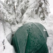 Royalty-Free Stock Photo: Tent Buried in Snow in Misty Winter Landscape