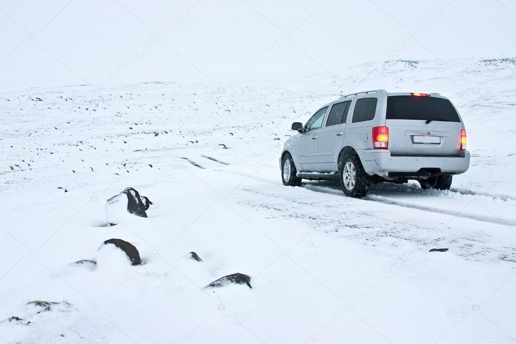 Offroad Car on the Snowy Road in Blizzard — Stock Photo #16863557