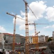 Three Huge Cranes on Construction Site in the Centre of a City — Stock Photo #26854103