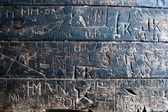 Texture of an Old Carved Script on Wooden Table — Stock Photo
