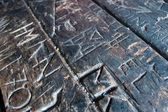 Texture of an Old Carved Script on Wooden Table — Φωτογραφία Αρχείου