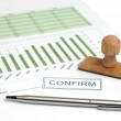 Foto de Stock  : A pen and sheet with table and graph
