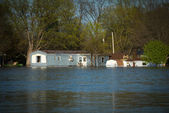 Small building in flood water — Stock Photo