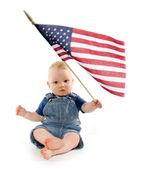 Baby boy with United States flag — Stock Photo