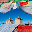 Prayer flags surround a tibetan monastery — Stock Photo