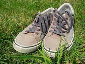 Sneakers in the grass — Stock Photo