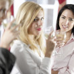 Women enjoying a glass of wine — Stock Photo #23021762