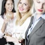 Women enjoying a glass of wine — Stock Photo #23021856