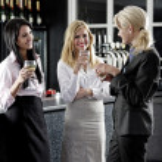 Women enjoying a glass of wine — Stock Photo #23021934