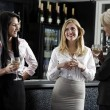 Women enjoying a glass of wine — Foto Stock