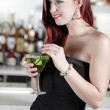 Woman enjoying a cocktail — Stock Photo #23022062