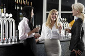 Women enjoying a glass of wine — Stock Photo
