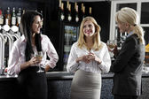 Women enjoying a glass of wine — Stock Photo