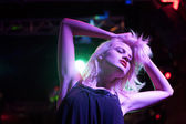 Woman dancing in nightclub — Stock Photo