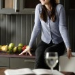 Woman in her stylish kitchen — Stock Photo