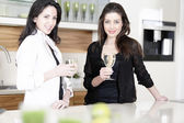 Two friends in a kitchen — Stock Photo