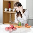 Woman reading cookery book — Stock Photo