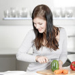Woman reading cookery book — Stock Photo #31101867
