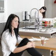 Two friends catching up in the kitchen — Stockfoto #31194361