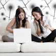 Two friends on a laptop at home — Stock Photo