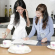 Two friends looking at recipes — Stock Photo