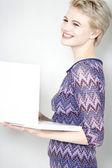 Woman holding laptop — Stock Photo
