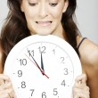 Woman holding clock — Stock Photo #38848753