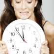 Womholding clock — Stock Photo #38848753